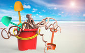 Octopus inside pail with shovel — Stock Photo