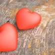 Stock Photo: Hearts on Wooden Board