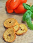 Tomatoes,basil, toasted bread — Stock Photo
