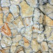Cobblestone background. The old cobblestone wall. — Stock Photo