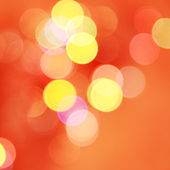 Red background with flashes. Blurry pattern of colorful decorat — Stock Photo