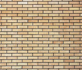Yellow brick wallThe facade view of yellow brick wall. — Stock Photo