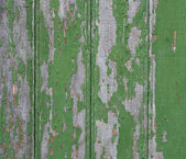 Old fence with peeling paint. Green old painted wooden backgroun — Stock Photo