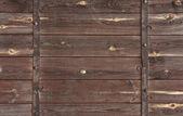 Trä bakgrund med metall dekorationer. — Stockfoto