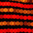 Holyday garland. Blurry pattern of colorful decoration lights. — Stock Photo