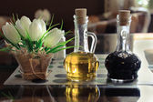 Bottles of olive oil and vinegar on a table in a cafe. — Stock Photo