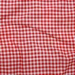 Red linen crumpled tablecloth.  — Stock Photo