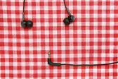 Headphones on textile — Stockfoto