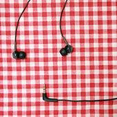 Headphones on textile — Stock Photo
