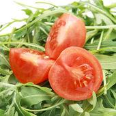 Arugula with tomatoes — Stock Photo