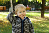Child with astonishment looks afar — Stock Photo