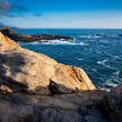 View from a cliff overlooking the ocean - Stock Photo