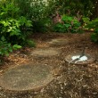 A Sundial Sits in a Dappled Garden Path — Photo