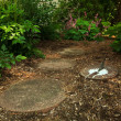 A Sundial Sits in a Dappled Garden Path — Stock fotografie