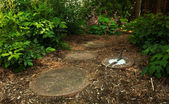 A Sundial Sits in a Dappled Garden Path — Stock Photo