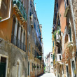 Narrow street in Venice, Italy - Stock Photo