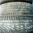 A stack of worn car tires — Stock Photo
