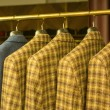 Yellow Checkered Suits on Rack — Stok fotoğraf