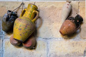 Different Urns on Wall — Stockfoto