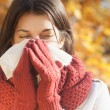 Women with tissue having flu or allergy — Stock Photo #19474193