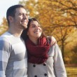 Beautiful embraced couple in the park. — Stock Photo