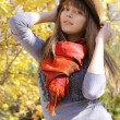 Funny girl posing in autumn park — Stock Photo