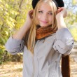 Young girl wearing a hat in autumn park - Stock Photo