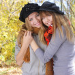 Two girls hugging in the autumn park — Stock Photo