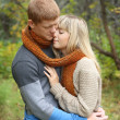 Romantic young couple embrace in Autumn Park — Stock Photo