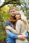 Young couple together in love hugging in autumn — Stock Photo