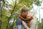 Young couple in love kiss each other — Stock Photo