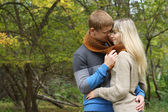 Young couple in love loking at each other .outdoor — Stock Photo