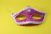 Venetian carnival purple mask yellow background — Stock Photo