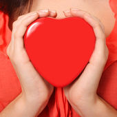 Red valentines heart box in woman hands, — Stock Photo