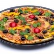 Pizza on a black plate — Stock Photo
