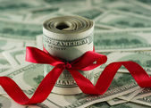 Dollars with a red bow — Stock Photo