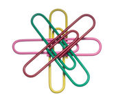 Colored paper clips on a white background — Stock Photo