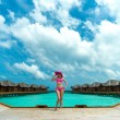 Woman on a beach jetty at Maldives — Stock Photo #26215567