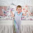 Little boy near the bed — Stock fotografie