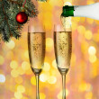 Flutes of champagne in holiday setting. — Stock Photo
