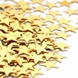 Christmas decoration of golden confetti stars against  — Stock Photo