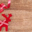 Christmas Reindeer on wooden background — Stock Photo