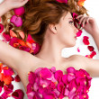 Stock Photo: Female waxing armpit in beauty salon. Ideal smooth clear skin. Beautiful womlying in rose petals. Depilation. Epilation