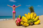 Tropical fruits on beach — Stock Photo