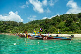 Thai boats awaiting tourists — Stock Photo