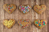 Heart shaped valentine cookies on a wooden board — Stock Photo
