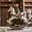 Vintage old rocking horse on a wooden background — Stock Photo #40966513
