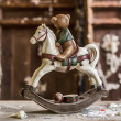 Vintage old rocking horse on a wooden background — Stock Photo
