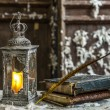 Vintage lamp for the candle and old books on wooden table — Stock Photo #40966535