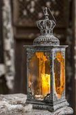 Vintage old lamp for the candle on wooden table — Photo